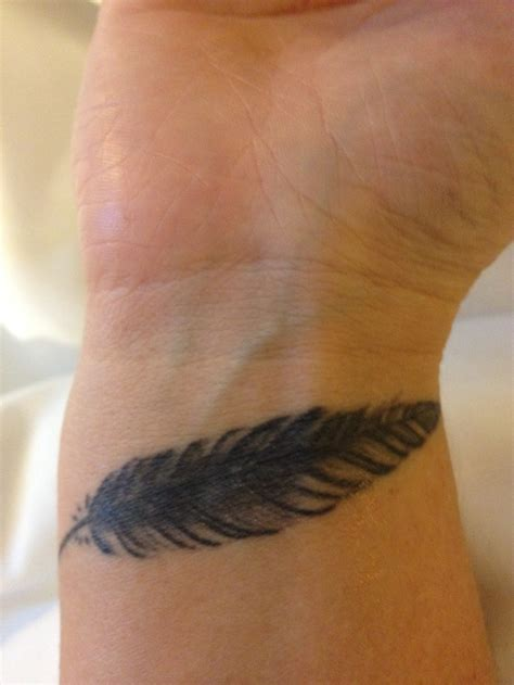 my feather tattoo on my wrist tattoos pinterest