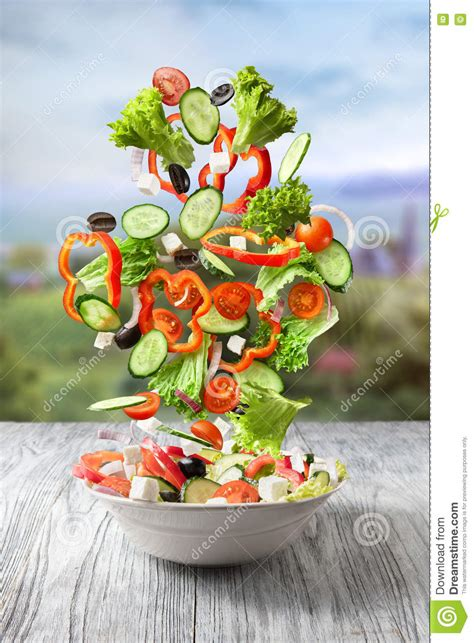 slices of design salad bowl by bosa stylepark fresh mixed vegetables falling into a bowl of salad stock