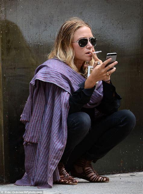 Mary kate olsen enjoys another smoke break in her favourite pashmina