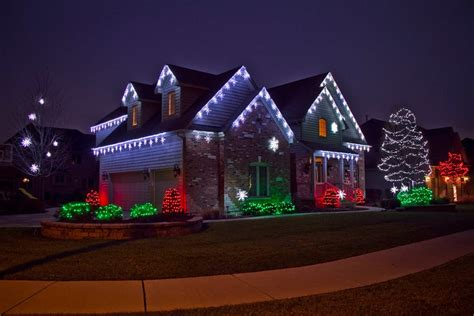 company to hang christmas lights 9 reasons to hire a professional lighting company
