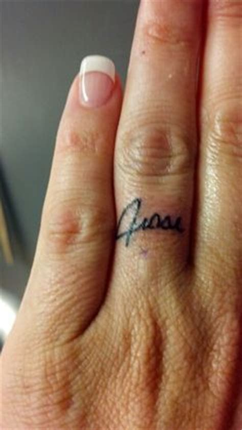 tattoo name wedding bands finger wedding band tattoo ink pinterest