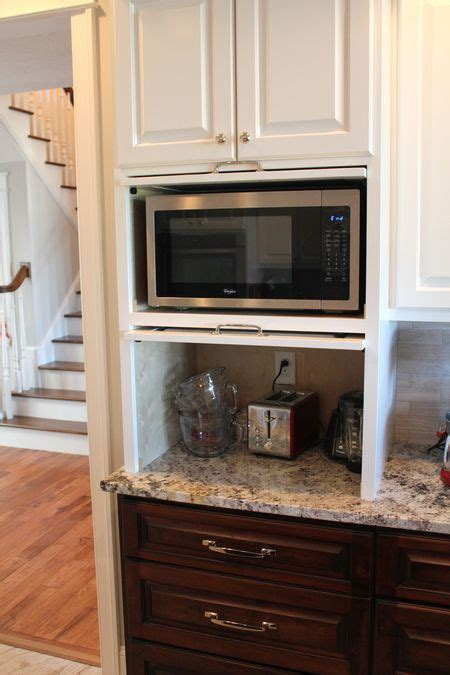kitchen cabinet garage micro appliance garage hides the microwave and small