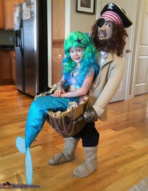 pirate blackbeard carrying  mermaid illusion costume