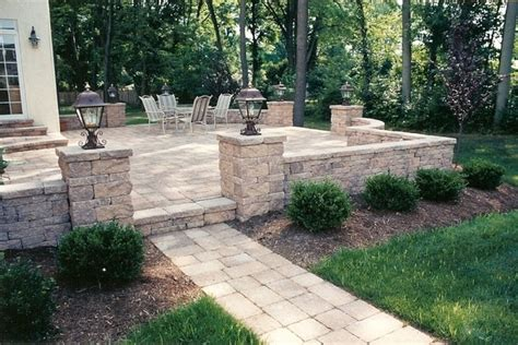 raised patio with walkway sitting walls and pillars with
