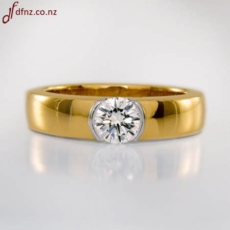 two tone brilliant white and yellow gold solitaire