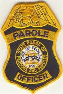 parole officers work in cars broadcasting