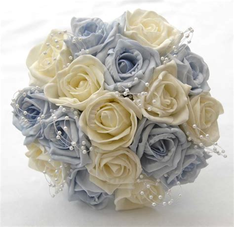 light blue and white roses light blue ivory rose bridesmiads wedding bouquet
