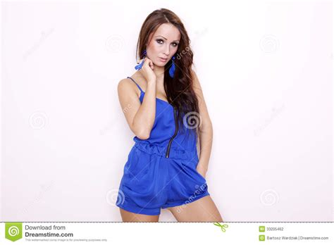 who is the brunette in the blue dress in the viagra add sexy brunette posing in blue dress stock photography