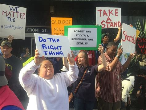 protesters rally in downtown san diego for disability