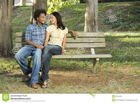 couple on park bench couple on park bench stock images image 3614404