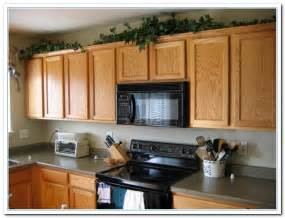 top of kitchen cabinet decorating ideas 28 top of cabinet decor chic on a shoestring