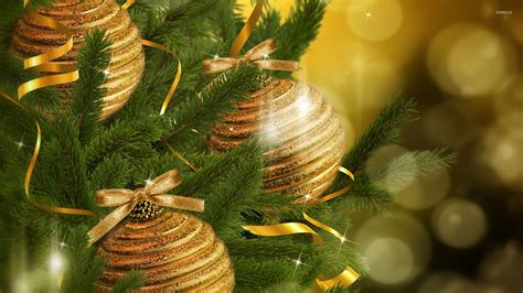 sparkly golden baubles in the christmas tree wallpaper