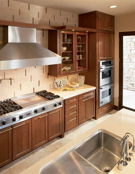 waypoint kitchen cabinets warm wood kitchen with cream tile and stainless