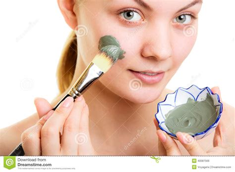 Masker Clay Pack skin care applying clay mud mask on stock