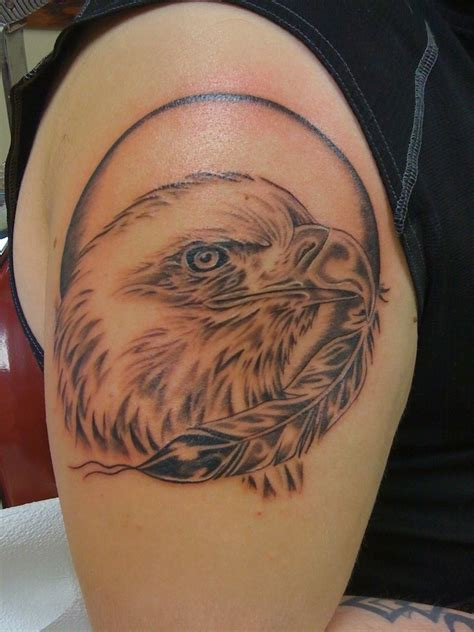 eagle head tattoos designs black and white eagle and feather on arm