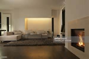 livingroom fireplace modern living room with fireplace and wooden floor stock