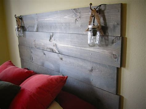 stained wood headboard with built in mason jar lights