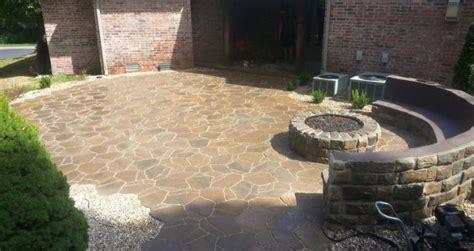 paver patio vs concrete patio vision landscape design