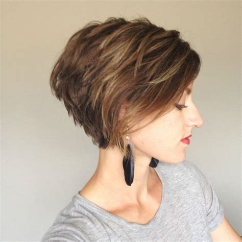 short pixie haircut with med brown and carmel highlights favorite low side swept bangs and enough length to wear