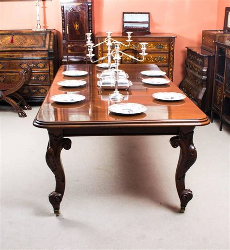 antique mahogany dining table and eight chairs