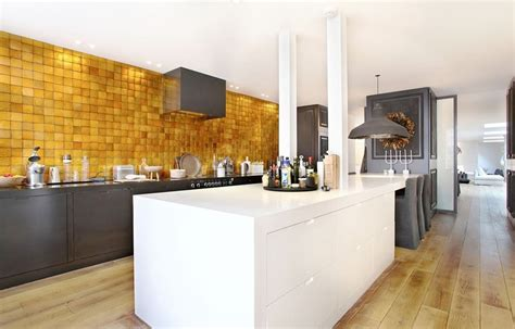 gold tile backsplash 8 golden backsplashes that will totally make you swoon