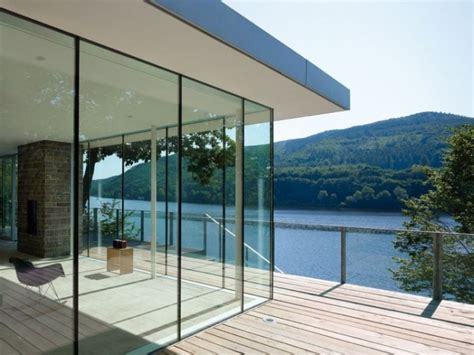 glass wall house modern german house clad in glass offers unabated lake views