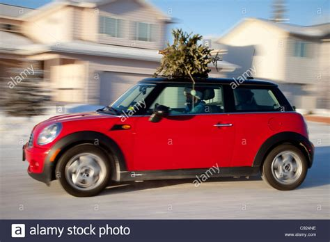 red mini cooper sports car with christmas tree on top