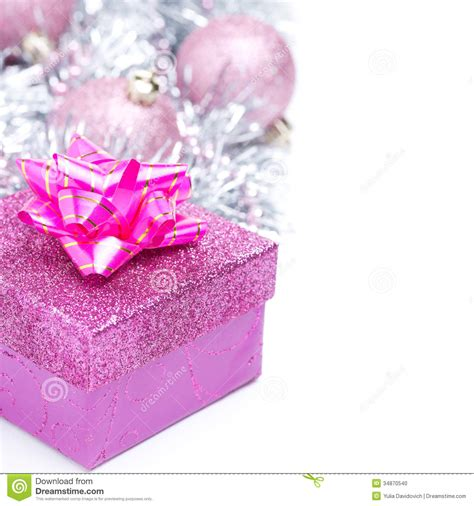 christmas composition with pink gift box and baubles