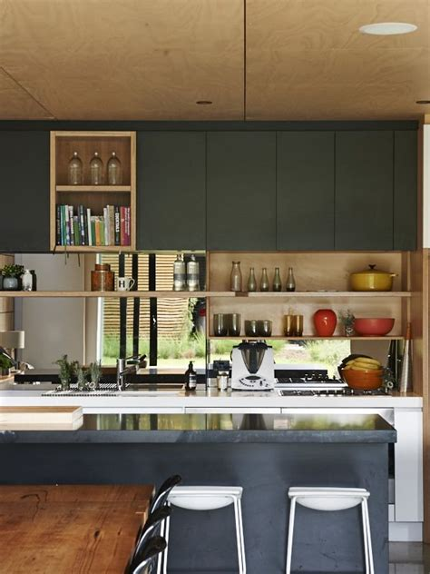 this melbourne kitchen includes a black caesarstone island
