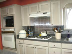 Faux Tin Kitchen Backsplash in de leon texas installed by lovely lady who did a great job as you