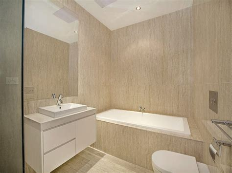 beige bathroom tile ideas white wall color with marble layers grey color ceramics wall layers