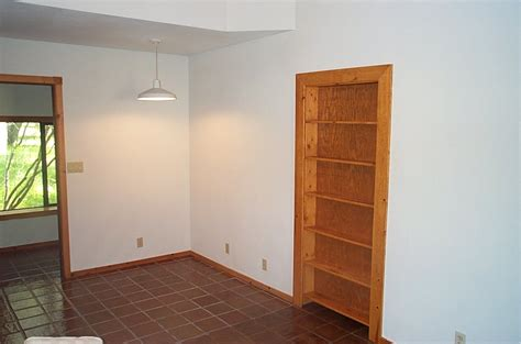 secret room concealed by bookcase door stashvault