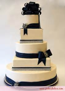 Maeghan s blog this 5 tier round and square cake is covered in ivory