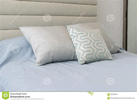 blue bed pillows comfortable pillows on the light blue bed stock image