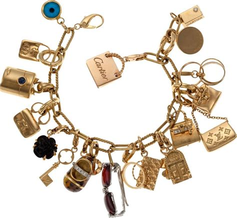 Charm Gold stunning 18k yellow gold charm bracelet with 19 18k gold