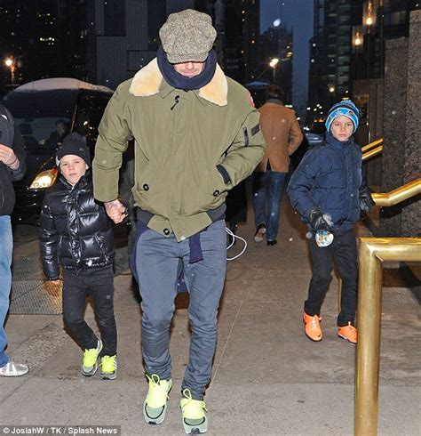 and sons trainer david beckham and his sons stand out in bright trainers