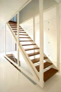 Suspended stair design by 123dv in dark wood and white frame