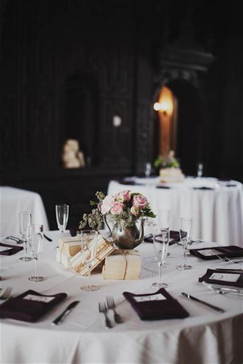 wonderful vintage wedding decor with books and flowers in tea pot wedding decor