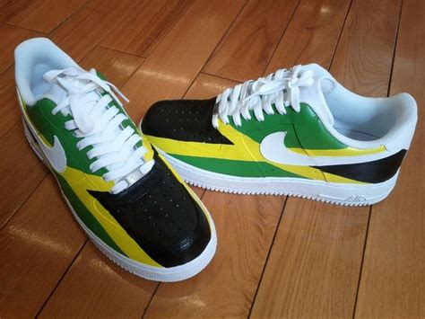 jamaican colored sneakers it shows the jamaican flag with the word or name