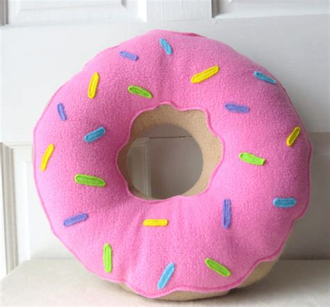pink frosted doughnut pillow by rabbits burrow