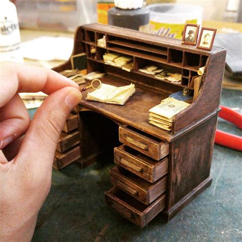 i built a miniature 1900s photo studio in honor of an