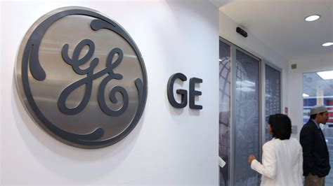 g e ge posts 13 6 billion loss on sale of finance assets