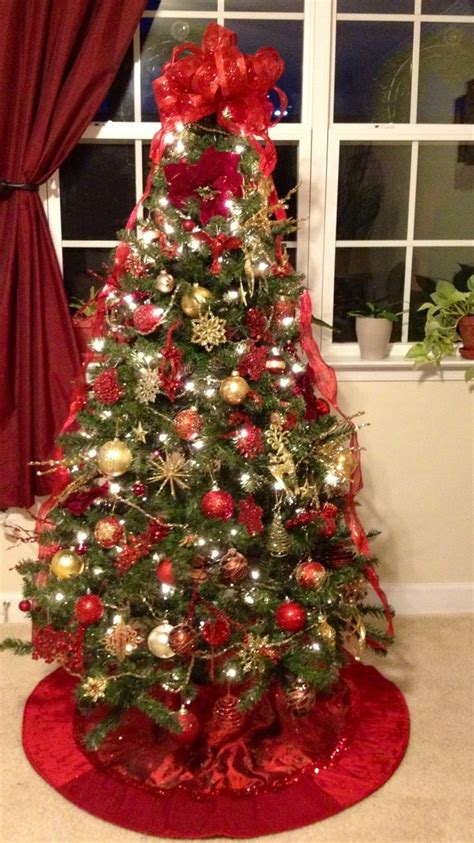 picture of a christmas tree with a red scarf aroud the top and gold tree 2017 best template idea