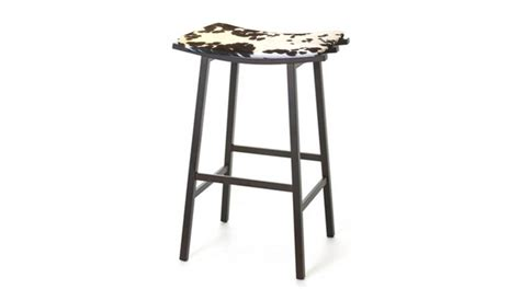 Looking Stool by Industrial Looking Counter Height Bar Stool With Faux Cow Hide Seat Cover