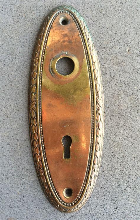 vintage brass door knob plate ornate edge