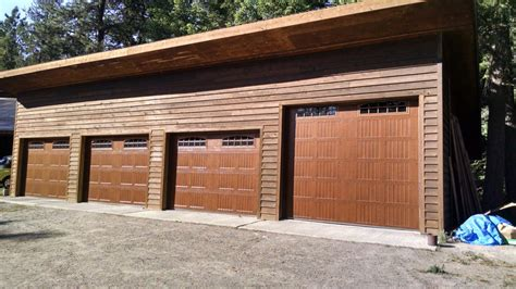 Complete Garage Door Thermatech Model 10c Metal Doors With A Laminated Wood Finish These Doors Transformed This