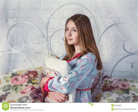 girl sitting on bed teen girl sitting on a bed stock photo image 53260062