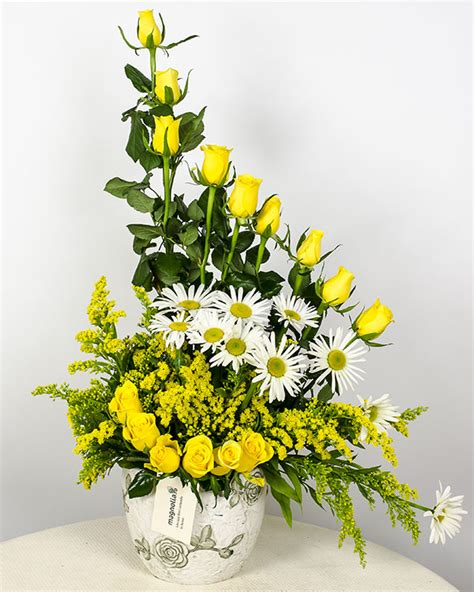 yellow roses soligado and white flowers arrangement