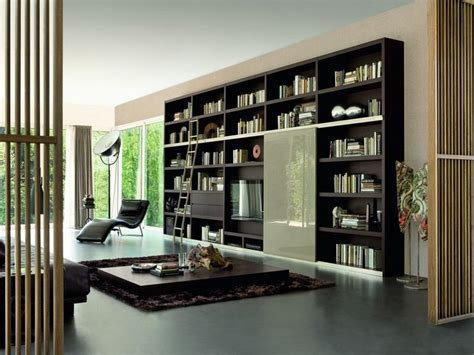 modern black wall mounted bookcase with lounge chair stroovi