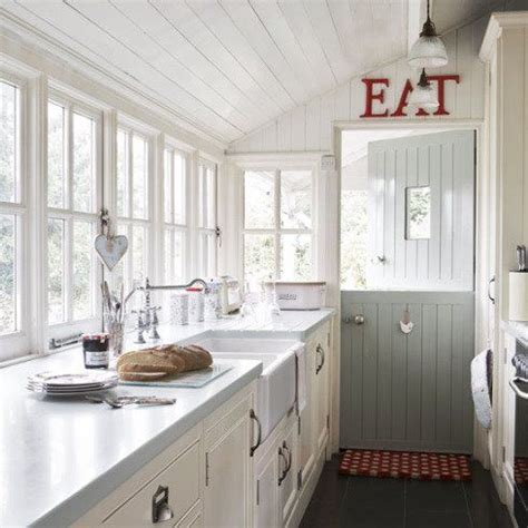 dutch door into kitchen in contrasting color and painted ceiling galley kitchen with farmhouse sink extras deep counters